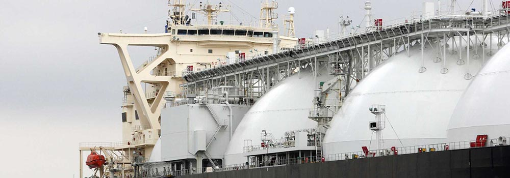 A liquefied natural gas (LNG) tanker operated by Energy Advance Co., a unit of Tokyo Gas Co., is moored at the company's Sodegaura plant in Sodegaura City, Chiba Prefecture, Japan, on Thursday, March 22, 2012. Japan's imports of LNG rose to a record last fiscal year as utilities turned to fossil fuels after the Fukushima nuclear disaster led to the shutdown of almost all the nation's atomic reactors. Photographer: Tomohiro Ohsumi/Bloomberg